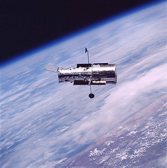 Hubble floating above Earth during servicing mission 3B, March 2002 | by Venom82