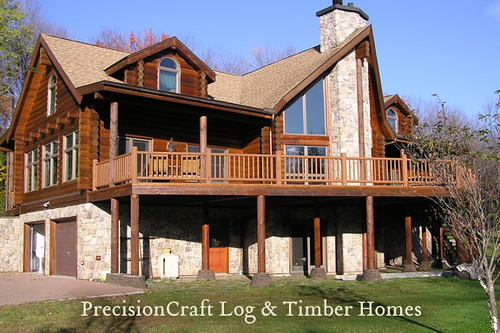 Custom log home exterior view by precisioncraft log ho for Three story log cabin