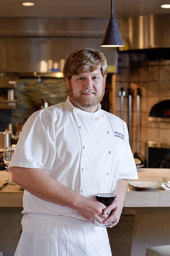 Chef Rob McDaniel stands in the restaurant, SpringHouse.