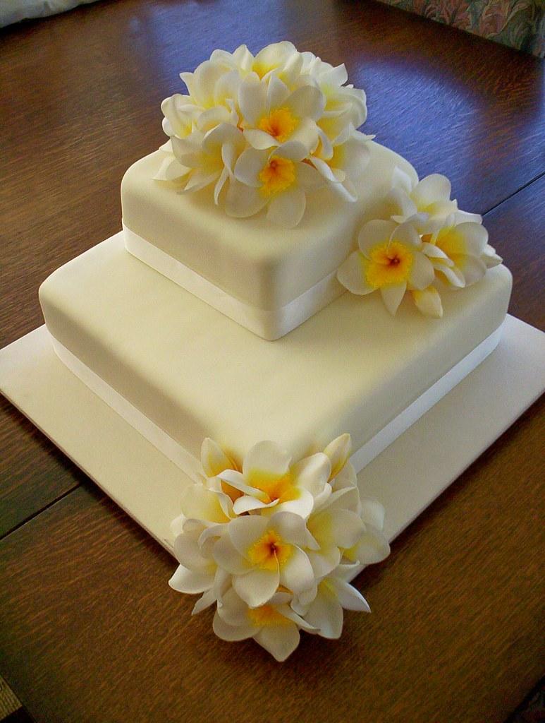 Silk Flower Frangipani Wedding Cake | Silk Flowers were used… | Flickr