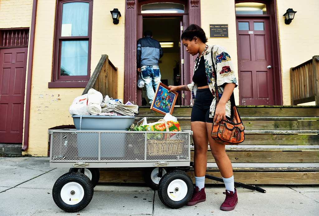© 2016 by The York Daily Record/Sunday News. Morgan Washington-Henry loads up a cart with items to bring to her new apartment from Bell Family Shelter in York Wednesday, Sept. 21, 2016.