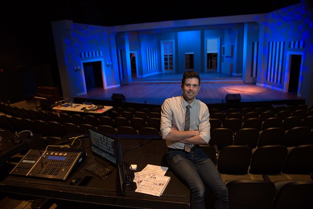 "Travis McHale poses with the stage of ""The Drowsy Chaperone"" in the background."