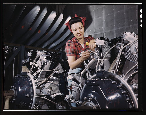 Woman working on an airplane motor at North American Aviation, Inc., plant in Calif.  (LOC) | by The Library of Congress