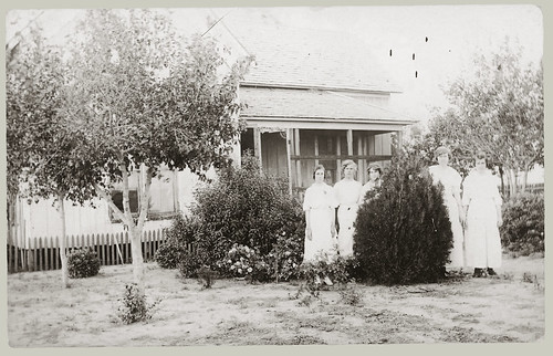 Five young women in the front yard