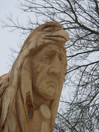 Native totem pole chainsaw carved cahinsaw carving of