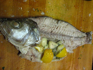 Whole Snapper In Process of Being Fileted | by SeppySills