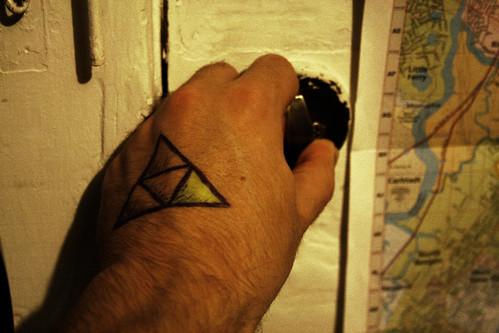 Zelda triforce tattoo hand the image for Triforce hand tattoo