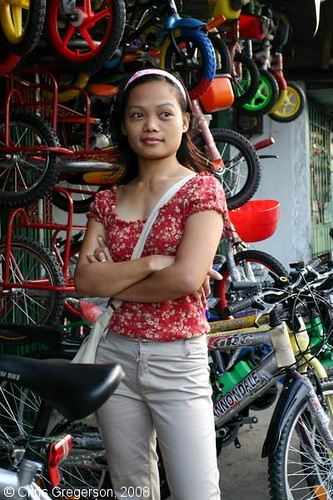 Woman Standing Outside A Bike Shop In Angeles City  Flickr-3297
