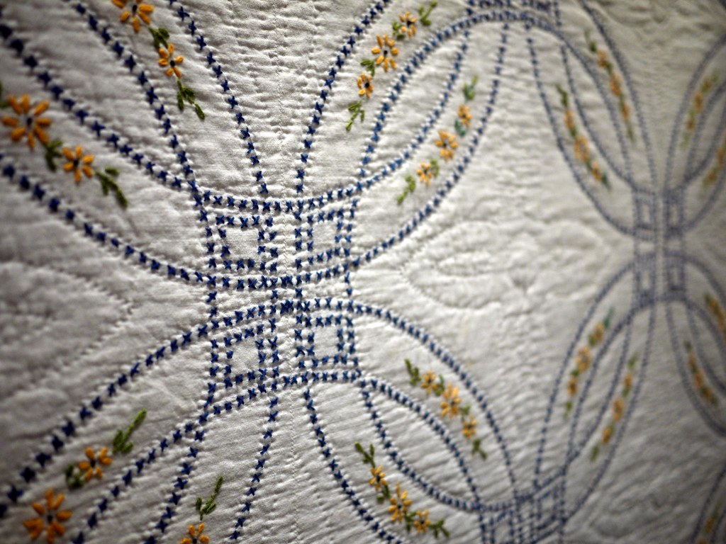 Embroidered double wedding ring quilt artist