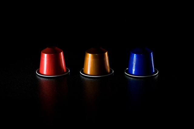 nespresso cups three nespresso cups on the kitchen table. Black Bedroom Furniture Sets. Home Design Ideas