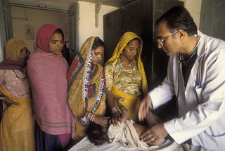 Infant patients gets a check up | by World Bank Photo Collection