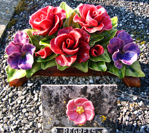 Ceramic Flower Arrangement And Plaque At The Cemetery Flickr