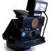 Polaroid SX-70 Sonar Autofocus (with Tourist flash; three-quarter view)