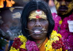Woman With Peaks In Her Tongue, Traditional Painting On Her Forehead And A Flower Garland During A Fire Walking Ceremony, Madurai, South India | by Eric Lafforgue