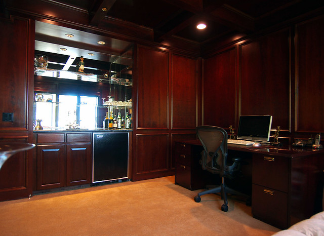 Cherry wood paneled ceilings walls in office with wet ba for Office wet bar