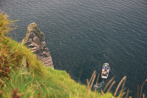 Looking down at the ferry on the Cliffs of Moher on the west coast of Ireland