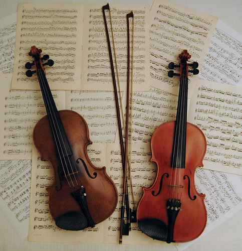 Violins with bows and music | by Photo Phiend