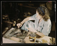 Transfusion donor bottles, Baxter Lab., Glenview, Ill. Formerly a sculptress and designer of tiles, Dorothy Cole converted her basement into a workshop to tin plate needles for valves for blood transfusion bottles prepared by Baxter Laboratories where she | by The Library of Congress