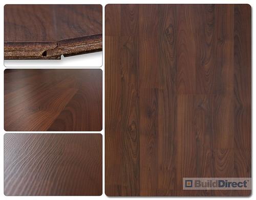 Chestnut Laminate Flooring With Dark Blue Kitchen Cabinents