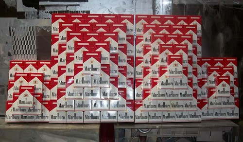 Cig Pyramids, Two Large, Two Small, dimensions variable, Marlboro boxes and glue | by John Norwood