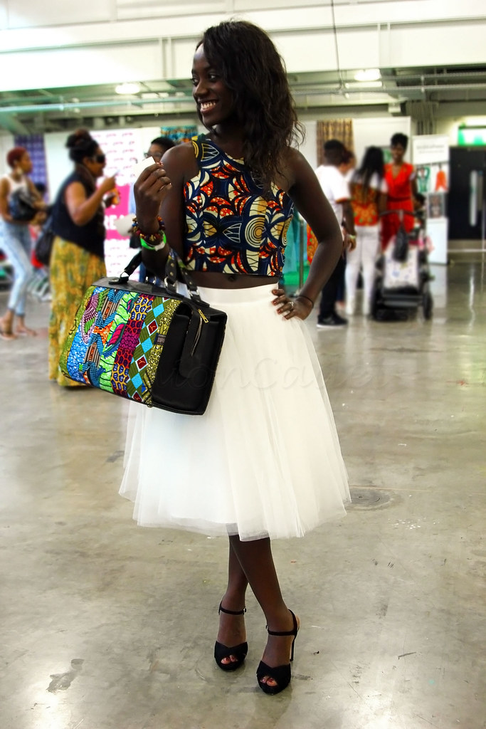white-tulle-midi-length-tulle-skirt-black-heeled-sandals-kitenge-ankara-chitenge-african-print-crop-top-bralet,How To Wear A Tulle Skirt Without Looking Like A Ballerina, How To Wear A Tulle Skirt Without Looking Like A Baby, How to Wear a Tulle Skirt Outfit, how to wear a tulle skirt to a wedding, how to wear a tulle skirt plus size, tulle skirt outfit for wedding, what kind of shirt to wear with a tutu, tulle skirt wedding guest, how to wear a tulle skirt to work, tulle skirt outfit for wedding guest, tips on how to wear a tulle skirt, Ways to Wear a Tulle Skirt in 2017, Ways to Wear a Tulle Skirt , How to Wear a Tulle Ballerina Skirt, white Tulle Ballerina Skirt, Ways to Style a Tulle Skirt Stylish and Trendy, white Ballerina Skirt, cream Ballerina Skirt, Ballerina Skirt, tutu skirt, cream tutu skirt, white tutu skirt, kitenge fashion 2016, Kenyan kitenge designs, African kitenge,  tulle fabric