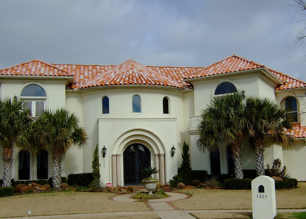 Tiled roof mediterranean fabulous mediterranean roof for Mission stucco