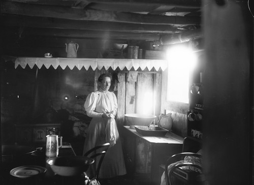 Woman inside a settler's hut | by Powerhouse Museum Collection