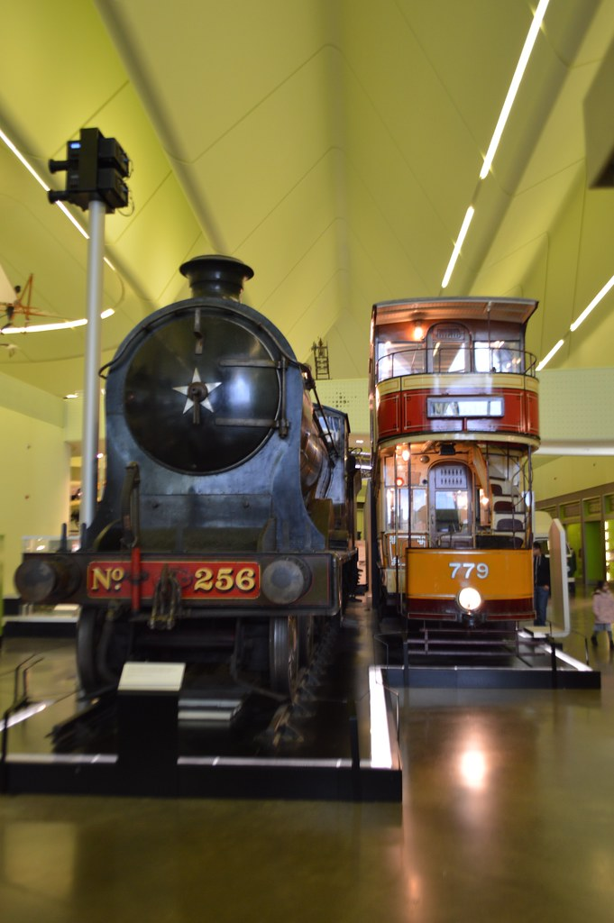 This is a picture of a locomotive and tram on exhibition in the Riverside Musem