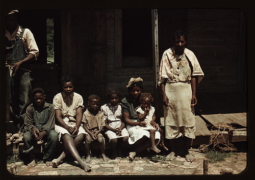 Bayou Bourbeau plantation, a FSA cooperative, Natchitoches, La. A Negro family (?) seated on the porch of a house  (LOC) | by The Library of Congress