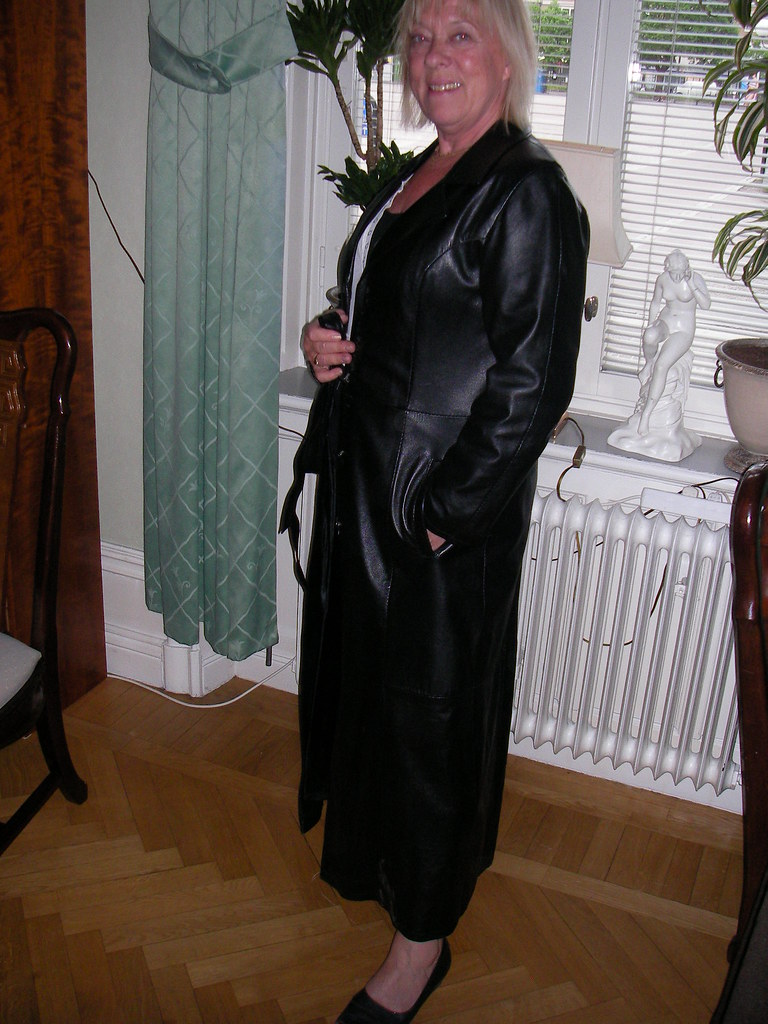 Leather Coat Lady Posing In Black Long Leather Coat