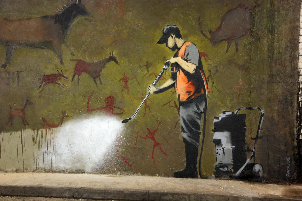 Banksy cleans up cave painting the latest work by for Banksy mural painted over