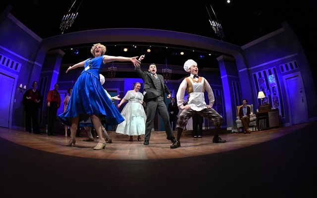 "The cast of ""The Drowsy Chaperone"" dances and sings on stage dramatically."