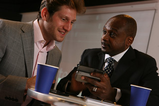Business meeting in coffee shop with Windows Mobile devices | by gailjadehamilton