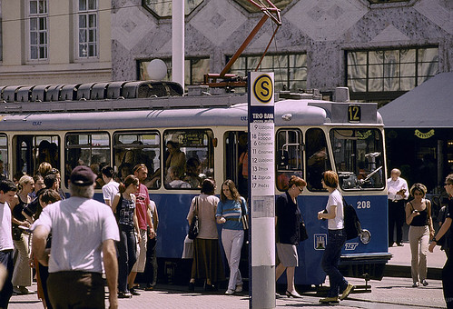 People boarding an electric bus | by World Bank Photo Collection