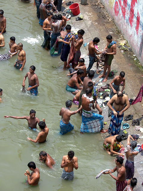 Open bath festival   by Tipu Kibria  BUSY. Open bath festival   They are all strong labors  Generally t    Flickr