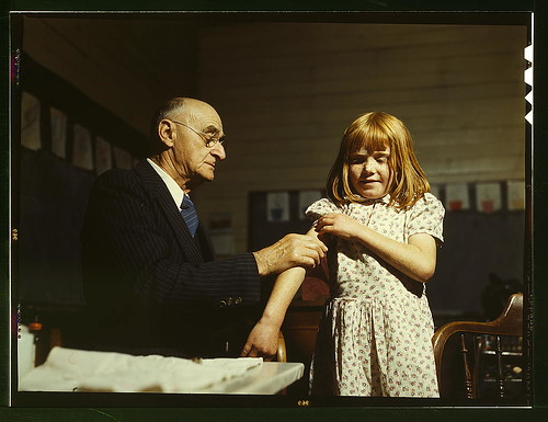 Dr. Schreiber of San Augustine giving a typhoid innoculation at a rural school, San Augustine County, Texas  (LOC) | by The Library of Congress