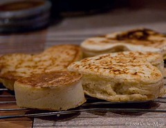 English muffins and crumpets cooling | by kitchenmage