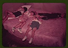 Children asleep on bed during square dance, McIntosh County, Okla.  (LOC) | by The Library of Congress