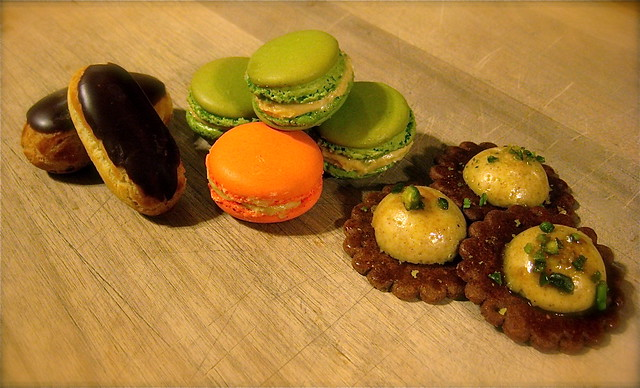 chocolate eclairs, orange and pistachio macarons, & pistac ...