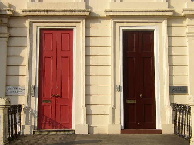 Double storm doors these are the main entrances to grand for Storm doors for double entry doors