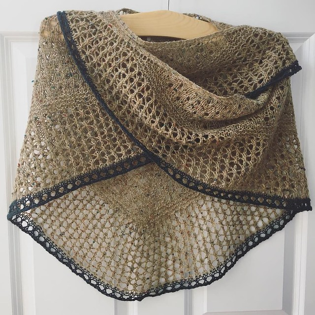 """Glitz at the Ritz after blocking. This ended up being a nice little shawl. I don't even mind the """"oops I ran out of yarn"""" blue border. #knitting #shawlknitting #glitzattheritz"""
