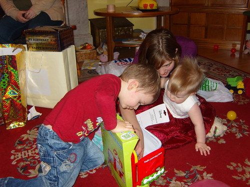 Big kids helping Fiona open presents | by superlori