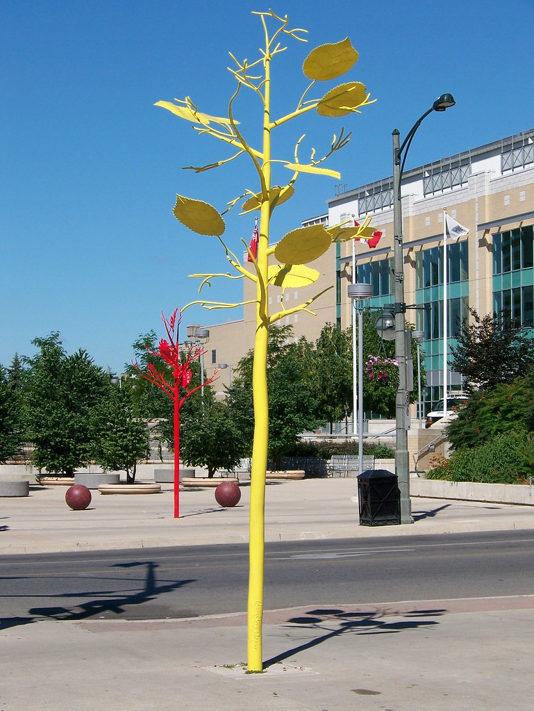 Yellow and red metal tree sculptures london ontario
