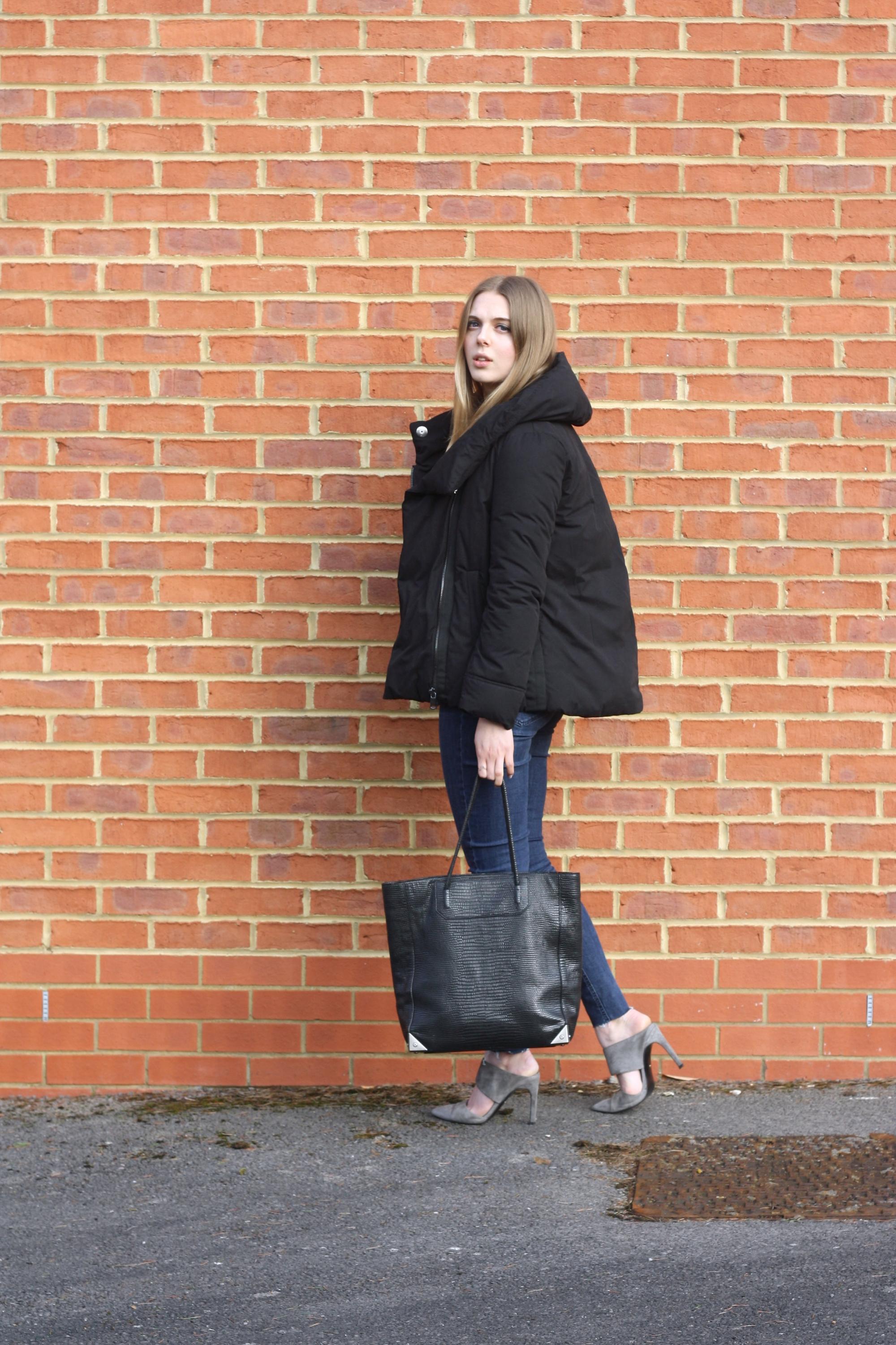 Alexander Wang Prisma black bag, Zara black padded jacket and Topshop Jamie indigo jeans