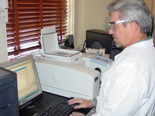 James Guidry is analyzing his samples using the Perkin-Elmer Fourier Transform Infrared Spectroscope. | by NPS | NCPTT
