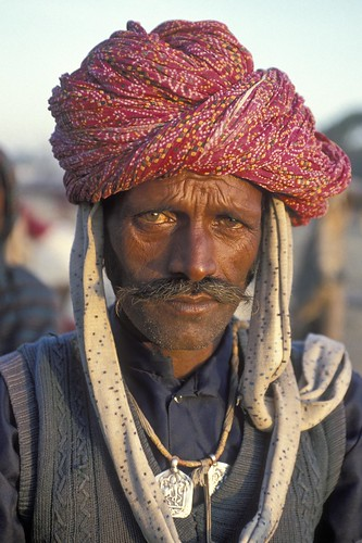 Portrait man with traditional headdress | by World Bank Photo Collection