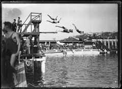 Group diving into Te Aro Baths, Oriental Bay, Wellington, 1926 | by National Library of New Zealand