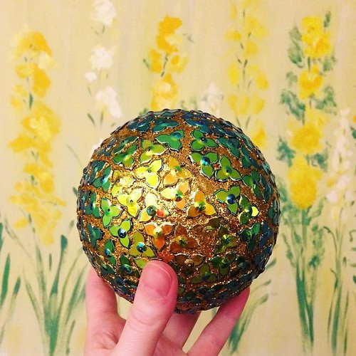 Josh bought me this fun decorative ball last night, which immediately began shedding gold glitter all over our son. Eh, he's five weeks old, time to start experiencing what this household is all about! ✨🌟✨