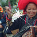 Red Zao woman embroidering a shirt at the weekly market in Sapa. Vietnam