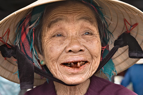 Aged woman with red betel nut stains in her mouth, Hoi An, Vietnam | by David Halbakken